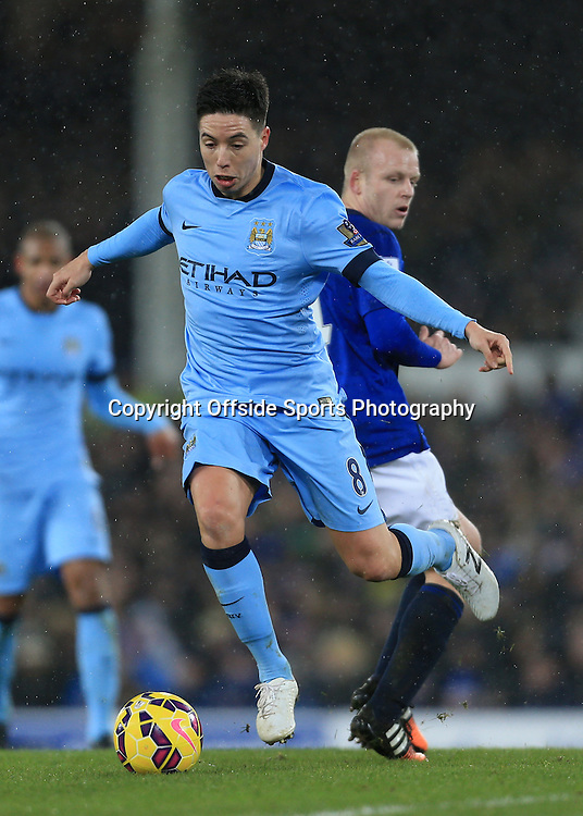 10th January 2015 - Barclays Premier League - Everton v Manchester City - Samir Nasri of Man City skips over a challenge from Steven Naismith of Everton - Photo: Simon Stacpoole / Offside.