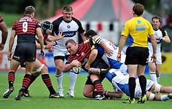 Saracens prop Matt Stevens is tackled to ground - Photo mandatory by-line: Patrick Khachfe/JMP - Tel: Mobile: 07966 386802 - 22/09/2013 - SPORT - RUGBY UNION - Allianz Park, London- Saracens v Bath Rugby - Aviva Premiership.