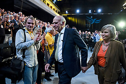 © Licensed to London News Pictures. 18/09/2018. Brighton, UK.  Liberal Democrat leader VINCE CABLE is joined by his wife RACHEL as he leaves the stage after delivering his leaders speech on the final day of the Liberal Democrat Autumn Conference in Brighton, East Sussex on September 18, 2018. This years event has been mainly focused around Brexit, the UK's departure from the EU. Photo credit: Ben Cawthra/LNP
