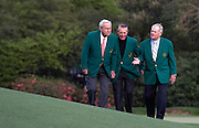 Golf legends, left to right, Arnold Palmer, Gary Player and Jack Nicklaus walk together on the 11th green during a practice round prior to the Masters golf tournament at Augusta National Golf Club in Augusta, Georgia.