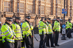 © Licensed to London News Pictures. 24/01/2015. Westminster, UK. Policemen look on as demonstrators in central London stage a mass protest against government plans to spend £100 billion replacing Trident, the UK's Cold War nuclear weapons system.  They encircled government and parliament buildings with a peace scarf knitted by thousands of people.. Photo credit : Stephen Chung/LNP