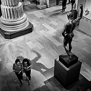 Cellphones seems to attract more attention than the nude young Roman at the Metropolitan Museum of Art.