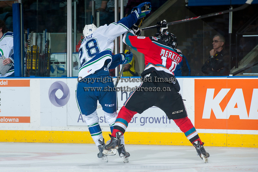 KELOWNA, CANADA - OCTOBER 7: Coda Gordon #28 of Swift Current Broncos collides with Nick Merkley #10 of Kelowna Rockets on October 7, 2014 at Prospera Place in Kelowna, British Columbia, Canada.  (Photo by Marissa Baecker/Getty Images)  *** Local Caption *** Coda Gordon; Nick Merkley;