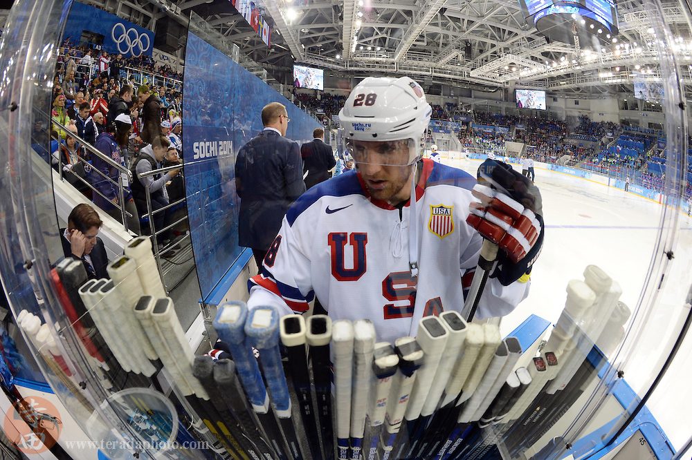 Feb 16, 2014; Sochi, RUSSIA; USA forward Blake Wheeler (28) selects a stick during the second period in a men's ice hockey preliminary round game against Slovenia during the Sochi 2014 Olympic Winter Games at Shayba Arena.