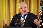Former German Chancellor Helmut Kohl speaks after President Bill Clinton presented him with the Medal of Freedom at the White House April 20, 1999. Kohl received the medal for his many years of good relations with the U.S and is the first foreigner to receive the honor since 1991.