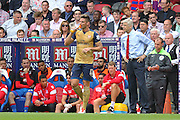 Arsenal Manager Arsene Wenger and Olivier Giroud of Arsenal after his goal during the Barclays Premier League match between Crystal Palace and Arsenal at Selhurst Park, London, England on 16 August 2015. Photo by Phil Duncan.