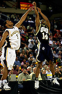 25 November 2005: Oral Roberts University senior, Jonathan Bluitt (14), takes a shot over Marquette guard, Dominic James, in the 70-73 loss to Marquette University at the Great Alaska Shootout in Anchorage, Alaska