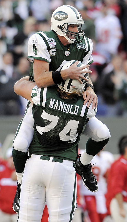 The Jets' Brett Favre (L) celebrates with teammate Nick Mangold (R) after completing a touchdown pass to Laveranues Coles during the fourth quarter of the game between the Kansas City Chiefs and the New York Jets at Giants Stadium in East Rutherford, New Jersey on 26 October 2008. The Jets won, 28-24.