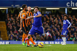 Diego Costa of Chelsea appears to dive in a challenge from Tom Huddlestone of Hull City and is awarded a yellow card by referee Chris Foy - Photo mandatory by-line: Rogan Thomson/JMP - 07966 386802 - 13/12/2014 - SPORT - FOOTBALL - London, England - Stamford Bridge - Chelsea v Hull City - Barclays Premier League.