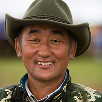 A Mongolian cowboy dressed up for the Nadaam festival in North East Mongolia.