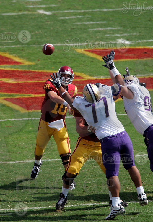 7 October 2006: USC starting quarterback #10 John David Booty throws a pass over the head of #77 Erick Lobos a view from overhead during  NCAA College Football Pac-10 USC Trojans 26-6 win over the Washington Huskies at the LA Coliseum during a sunny saturday game in Los Angeles, CA.<br />