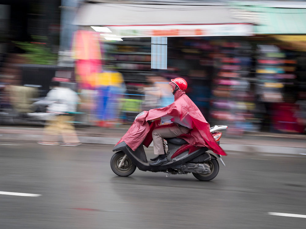 Asia, Viet Nam, Ho Chi Minh City. People riding scooters. Editorial Use Only.