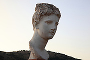 Head of a young Roman in the courtyard of the Venetian castle, a copy of a statue of the god Apollo, Butrint, Chaonia, Albania. Butrint was founded by the Greek Chaonian tribe and was a port throughout Hellenistic and Roman times, when it was known as Buthrotum. It was ruled by the Byzantines and the Venetians and finally abandoned in the Middle Ages. The ruins at Butrint were listed as a UNESCO World Heritage Site in 1992. Picture by Manuel Cohen