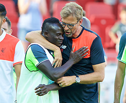 MAINZ, GERMANY - Sunday, August 7, 2016: Liverpool's manager Jürgen Klopp and Sadio Mane after the pre-season friendly match against FSV Mainz 05 at the Opel Arena. (Pic by David Rawcliffe/Propaganda)