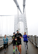 Ultra-marathon runner Daren Wendell, center, runs across the George Washington Bridge on Friday, April 10, 2015, in New York, marking the 100th consecutive day of his cross country journey. Wendell departed from the Santa Monica Pier on January 1, 2015 and ran more than 29 miles per day, with a titanium rod called the Stryker T2 Tibia Nail in his leg, to raise money for Activewater.  Joining him are Katherine Uyeda, of New York, Aurek Deischer, of Linton, Ind., and Erika Dorsey, of Mays Landing, N.J.  (Photo by Diane Bondareff/Invsion for Stryker/AP Images)