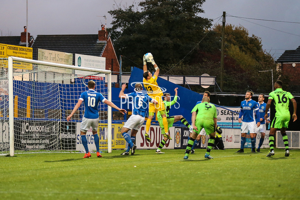 Macclesfield's goalkeeper Craig Ross claims a cross during the Vanarama National League match between Macclesfield Town and Forest Green Rovers at Moss Rose, Macclesfield, United Kingdom on 12 November 2016. Photo by Shane Healey.