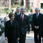"""Pres. Bush, First Lady Laura Bush, former Presidents George H.W. Bush and William Jefferson Clinton, visit the Indonesian Embassy after the country was devastated by the tsunami Monday, January 3, 2005.  President Bush told reporters at the White House, """"I have asked two of America's most distinguished private citizens to head a nationwide charitable fund-raising effort.""""..Photo by Khue Bui"""