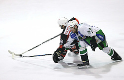 Jean Philippe Pare of Jesenice vs Andrej Tavzelj of Olimpija at 2nd final match of Slovenian National Championships  between HK Acroni Jesenice and HDD Tilia Olimpija, on March 17, 2009, in Podmezaklja, Jesenice, Slovenia. Acroni Jesenice won after free shots 2:1 and are leading 2:0. They need to win 2-times more. (Photo by Vid Ponikvar / Sportida)