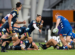 Highlanders' Aaron Smith, centre, delivers a pass against the Stormers in the Super Rugby match, Forsyth Barr Stadium, Dunedin, New Zealand, Friday, March 9, 2018. Credit:SNPA / Adam Binns ** NO ARCHIVING**