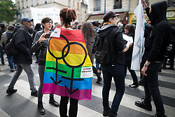 © Licensed to London News Pictures. 16/04/2017. Paris, France. A woman wrapped in a rainbow pride flag . Antifascist protesters opposed to a meeting by French far-right party , Front National , hold a demonstration in the North East of Paris . Photo credit: Joel Goodman/LNP