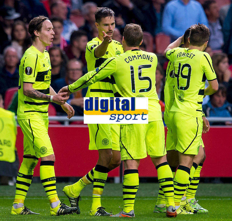 17/09/15 UEFA EUROPA LEAGUE GROUP STAGE<br /> AJAX v CELTIC<br /> AMSTERDAM ARENA - HOLLAND<br /> Celtic's Mikael Lustig (2nd from left) celebrates his goal with his team-mates
