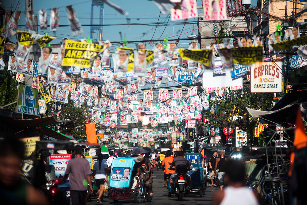MANILA, PHILIPPINES - MAY 9: Posters of candidates hanging in streets of Tondo, Manila, Philippines on Monday morning of May 9, 2016. <br /> <br /> Photo by Richard A. de Guzman