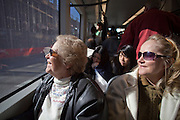 28 DECEMBER 2008 -- PHOENIX, AZ: ROXINE RIORDAN (left) and RENITA JURGENSEN, both from Mesa, AZ, look out a window while they ride the new Metro light rail system for the first time Sunday. The new Metro Light Rail is 20 miles long and cost $1.4 billion dollars. Construction was funded by local, state and federal monies. The trains will operate on one line through Phoenix and the suburban communities of Tempe and Mesa. The trains started running Saturday, Dec 27, 2008 and will be free until Jan. 1, 2009. The regular fare will be $1.25 for one ride or $2.50 for an all day pass.  Photo by Jack Kurtz / ZUMA Press