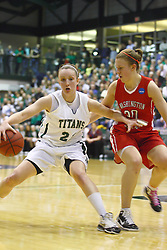 18 March 2011: Olivia Lett changes directions with Kristin Anda guarding during an NCAA Womens basketball game between the Washington University Bears and the Illinois Wesleyan Titans at Shirk Center in Bloomington Illinois.