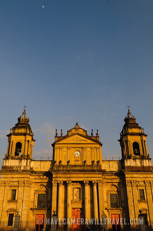 Catedral Metropolitana against an early evening clear blue sky just before sunset in the center of Guatemala City, Guatemala.