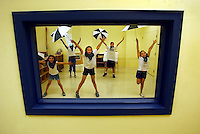 "Gloucester: Children rehearse for a dance number shortly before the opening ceremonies of the new Child Development Programs building on Emerson Avenue Thursday. The children sang and dance to ""Singing in the Rain."" Left to right are Macy Tocco, Leidy Marrero, Hailey Howell, Josh Davis, and Vanessa Chaisson. (Photo by Mike Dean/Gloucester Daily Times). Thursday, June 12, 2003 (NOTE: THIS IS A DIGITAL CAMERA IMAGE)..**************************************.Filter: Min (QMPro: Red Radius:3/Blue Radius:9/Desp.).USM: Normal (Amt:200/Radius:0.3/Thresh:2).File Size: 7.67MB.Original file name: DSC_7934.JPG"