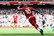 Liverpool forward Sadio Mane (10) wheels away after scoring the Liverpool equalizer and urges his team mates to get back to restart the game during the Premier League match between Liverpool and Newcastle United at Anfield, Liverpool, England on 14 September 2019.