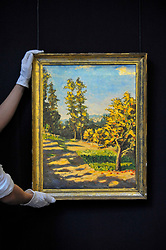 "© Licensed to London News Pictures. 17/11/2017. London, UK.  London, UK.  17 November 2017. A technician presents ""Landscape with Two Trees"", 1922, by Sir Winston Churchill (Est. GBP 100-150k).  Preview upcoming auctions of Modern & Post War British Art and Scottish Art taking place at Sotheby's, New Bond Street, on 21 and 22 November. Photo credit: Stephen Chung/LNP"