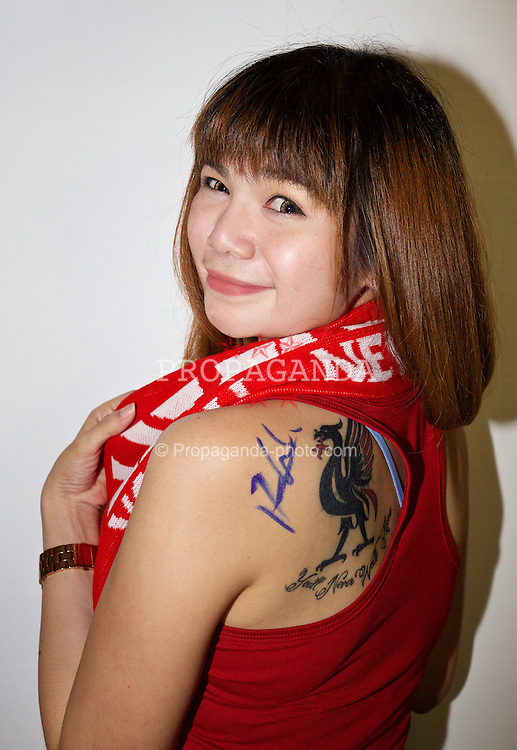 BANGKOK, THAILAND - Monday, July 13, 2015: Liverpool supporter Photjanee, 33, from Bangkok, with a Liverbird tattoo, waits for autographs from the players at the Plaza Athenee team hotel in Bangkok on day one of the club's preseason tour. (Pic by David Rawcliffe/Propaganda)