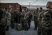 16th BC French unit soldiers participate to the last briefing before taking their last convoy to go to KAIA airport on September 29, 2012  in Warehouse base in Kabul. The French unit from Bitche (Moselle) spent a week disassembling weapons, cleanning tanks and preparing their departure for France. AFP PHOTO / JEFF PACHOUD