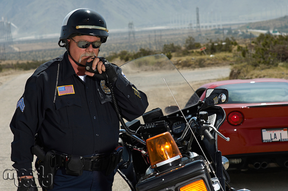 Portrait of traffic cop using radio