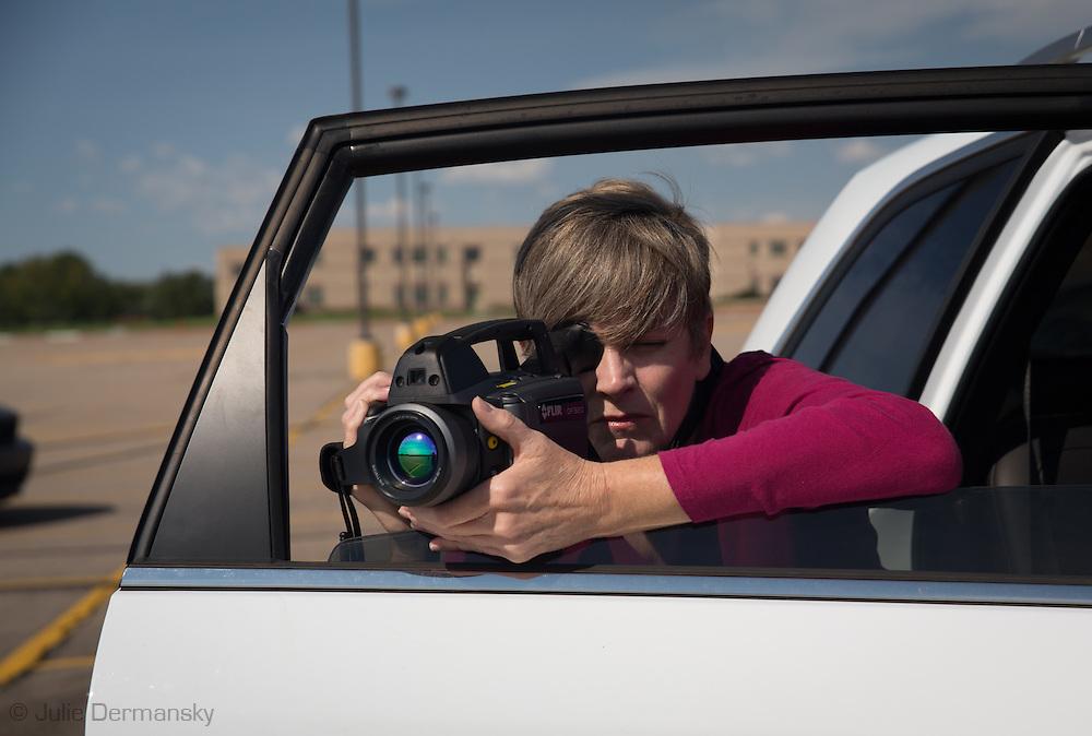 Sept 14th, 2014, Sharon Wilson, Earthwork's Gulf Regional Organizer using a FLIR camera in Greeley Colorado in Weld County. Wilson filmed a fracking site next to Northridge HighSchool.