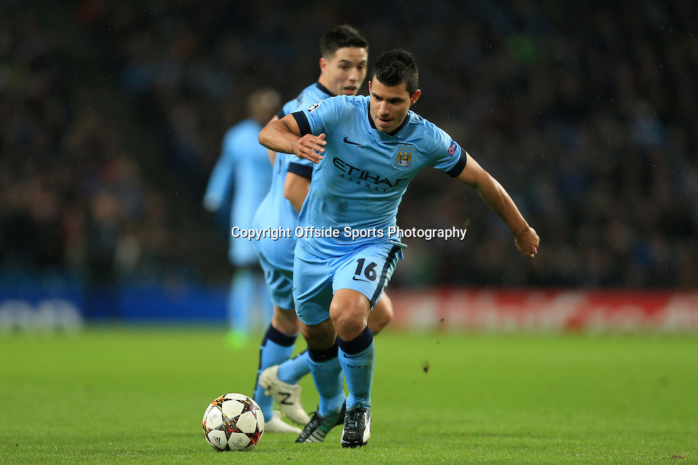 25th November 2014 - UEFA Champions League - Group E - Manchester City v Bayern Munich - Sergio Aguero of Man City is watched by teammate Samir Nasri - Photo: Simon Stacpoole / Offside.