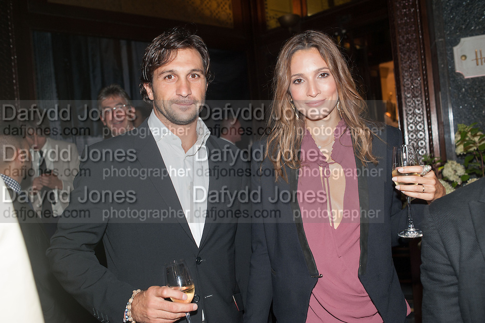 EDUARDO ESTRADA; ASTRID MUNOZ, Dinner to celebrate the opening of the first Berluti lifestyle store hosted by Antoine Arnault and Marigay Mckee. Harrods. London. 5 September 2012.
