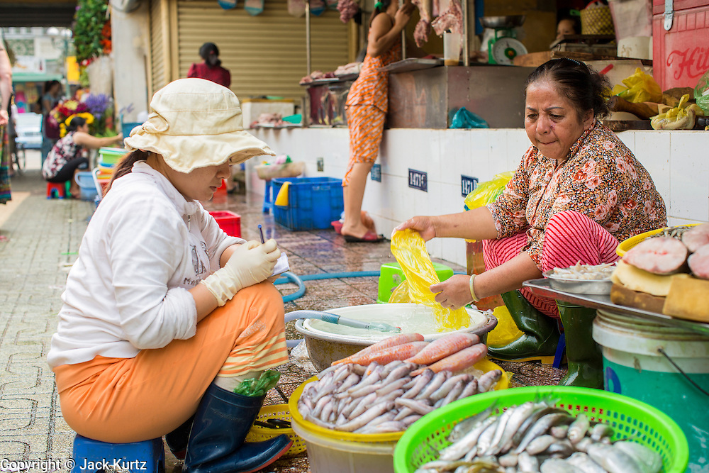 27 MARCH 2012 - HO CHI MINH CITY, VIETNAM:   Fish sellers in Ben Thanh Market, the main market in Ho Chi Minh City, Vietnam. The market has become the main tourist market. Ho Chi Minh City, which used to be known as Saigon, is the largest city in Vietnam and the commercial hub of southern Vietnam.     PHOTO BY JACK KURTZ