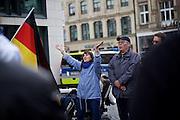 Frankfurt am Main   11 Apr 2015<br /> <br /> Am Samstag (11.04.2015) demonstrierten etwa 35 Personen der Gruppe &quot;Freie B&uuml;rger f&uuml;r Deutschland&quot; (FBfD, ex PEGIDA) auf dem Rossmarkt in Frankfurt am Main gegen &quot;Islamisierung&quot;, ihre Redebeitr&auml;ge gingen in dem Geschrei der etwa 800 Gegendemonstranten unter.<br /> Hier: FBfD-Aktivisten singen das Deutschlandlied.<br /> <br /> &copy;peter-juelich.com<br /> <br /> [Foto honorarpflichtig   No Model Release   No Property Release]