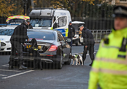 © Licensed to London News Pictures. 03/12/2019. London, UK. Sniffer dogs search vehicles at Winfield House in Regents Park, London, where President Donald Trump is staying during the NATO leaders summit. Worlds leaders are due to attend a series of events over a two day NATO summit which will mark the 70th anniversary of the alliance of nations. Photo credit: Ben Cawthra/LNP