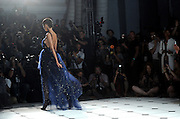 A model walks the runway at the Jason Wu spring 2013 show, Friday, Sept. 7, 2012 in New York. (Photo by Diane Bondareff/Invision/AP Images)