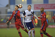 Ollie Rathbone is fouled during the The FA Cup 3rd round match between Barrow and Rochdale at Holker Street, Barrow, United Kingdom on 7 January 2017. Photo by Daniel Youngs.