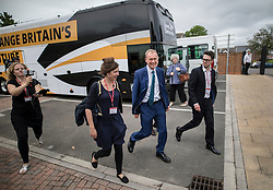 © Licensed to London News Pictures. 16/05/2017. Portsmouth, UK. Liberal Democrat party leader Tim Farron (C) arrives at the Mary Rose Academy special needs school by battle bus. The Lib Dems have today announced plans for education and business during campaigning for the general election on June 8, 2017.  Photo credit: Peter Macdiarmid/LNP