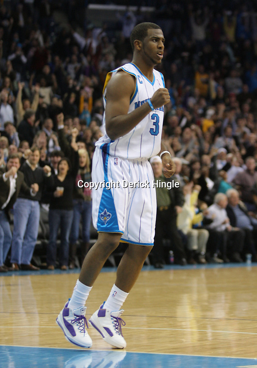 Jan 02, 2010; New Orleans, LA, USA; New Orleans Hornets guard Chris Paul (3) reacts after forward David West ((not pictured) hit a shot against the Houston Rockets during the fourth quarter at the New Orleans Arena. The Hornets defeated the Rockets 99-95. Mandatory Credit: Derick E. Hingle-US PRESSWIRE