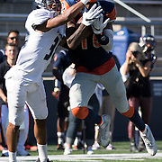 Orange Coast College wide receiver, James Rutledge (18) catches a pass defended by Fullerton College defensive back, Tim Gordon (38) in a CCCAA football game in Costa Mesa, California on November 5.<br /> Photo by Rachel Lacey Noll, Sports Shooter Academy