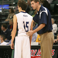 Wolves head coach Kyle DeWeese gives instructuibs to guard Shane Cooper (15)