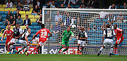 Millwall player Jordan Archer  together with the Millwall defence look to clear a Chesterfield cross into the box during the Sky Bet League 1 match between Millwall and Chesterfield at The Den, London, England on 29 August 2015. Photo by Bennett Dean.