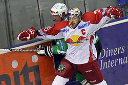 Pasi Petrilainen of Olimpija and Dieter Kalt of Salzburg at sixth game of the Final of EBEL league (Erste Bank Eishockey Liga) between ZM Olimpija vs EC Red Bull Salzburg,  on March 25, 2008 in Arena Tivoli, Ljubljana, Slovenia. Red Bull Salzburg won the game 3:2 and series 4:2 and became the Champions of EBEL league 2007/2008.  (Photo by Vid Ponikvar / Sportal Images)..