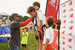 Meb Keflezighi presents medals to podium winners